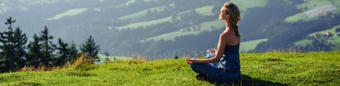 Woman doing Reiki and meditation
